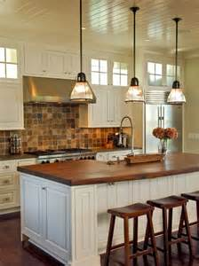 kitchen island chandeliers butcher block counter top brick backsplash design