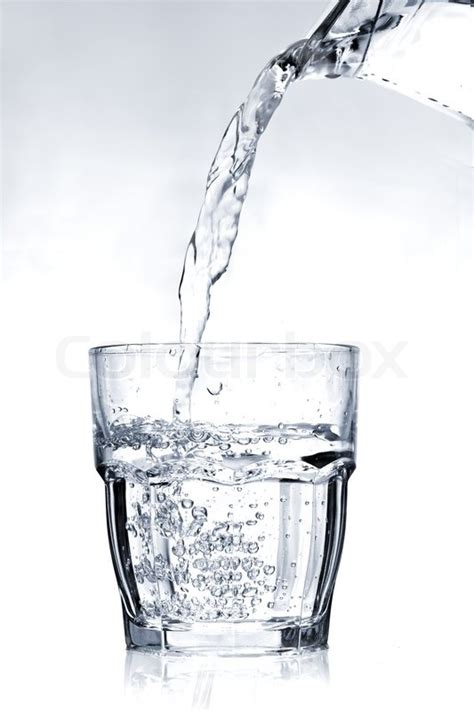 What To Fill Glass With Filling A Glass With Water On A Light Blue Background