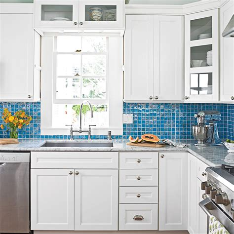 Country Green Kitchen Cabinets white kitchen with blue glass backsplash 9 breezy island