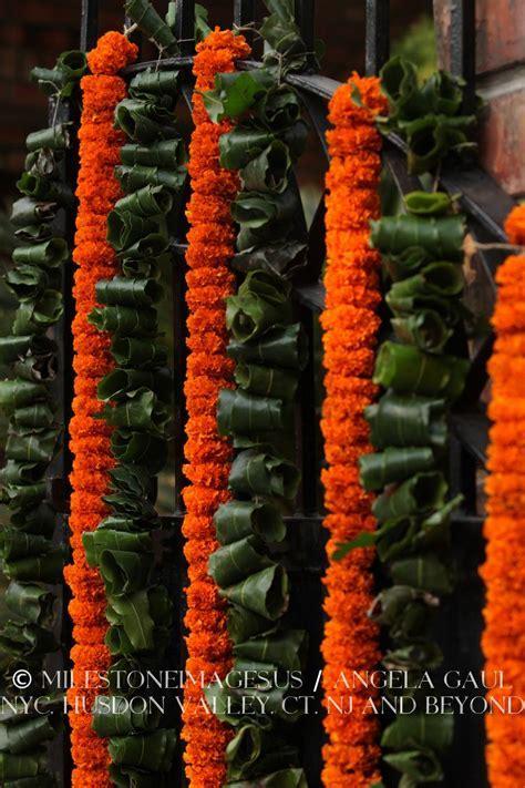 orange marigold garlands, traditional Indian wedding