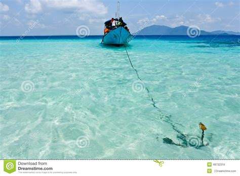 boat anchor on boat with anchor in tropical ocean near karimunjawa side