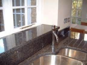 granite backsplash and windowsill white kitchen