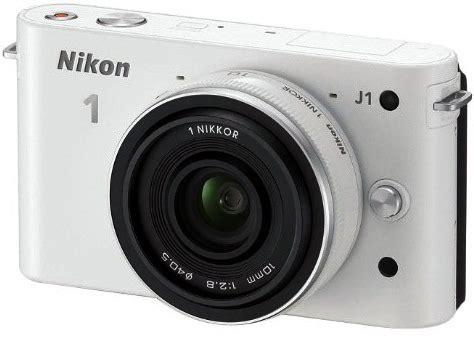 nikon   white digital camera  mm lens