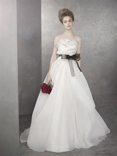 white by vera wang wedding dress with black sash