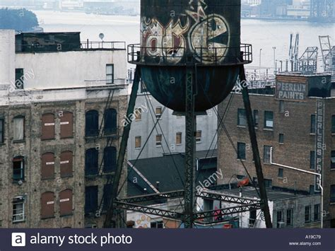 dumbo section of brooklyn a water tank on top of a building in the dumbo section of