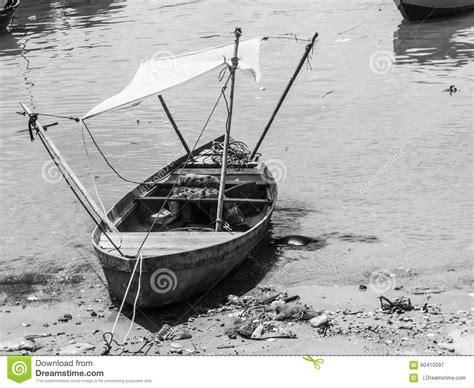 poor boat a poor wooden boat on the beach stock photo image 60410097