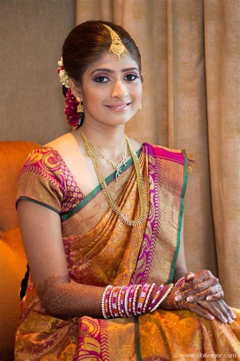 bridal hairstyles for silk saree traditional southern indian bride wearing bridal saree