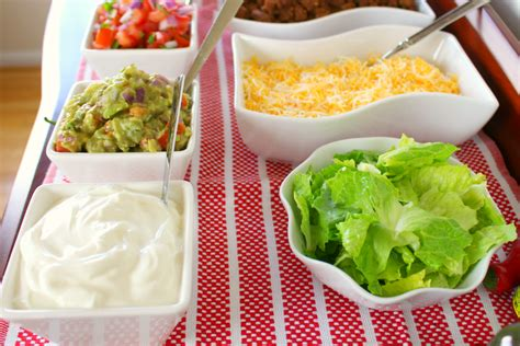 Taco Bar Toppings by How To Make Tacos And Taco Bar Ideas Genius Kitchen