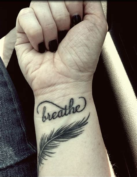 breathe tattoo on wrist my breathe and feather wrist tattoos motivating me