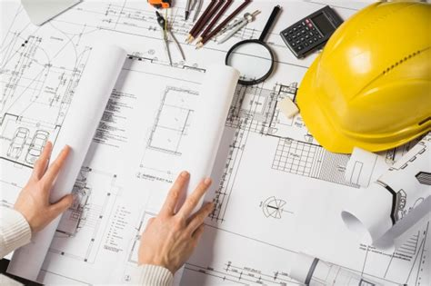 architect online crop architect opening blueprint photo free download
