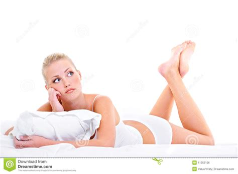 lying or laying in bed young bored woman lying down ot he bed royalty free stock