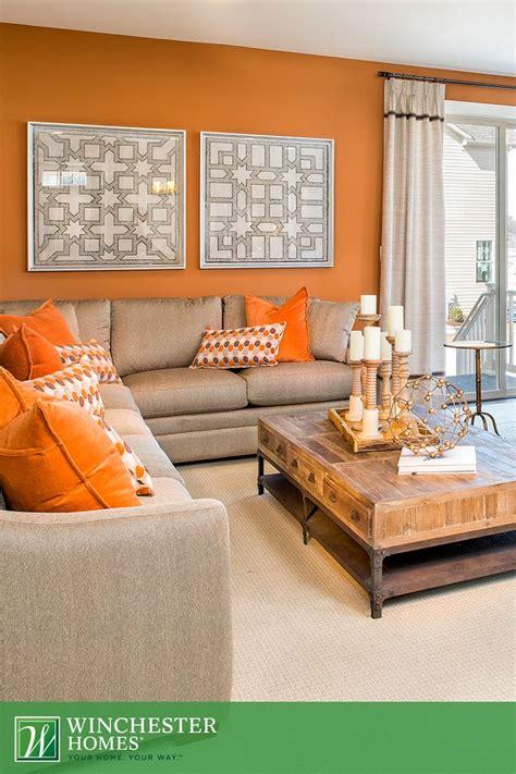 orange walls patterned artwork  light carpets add