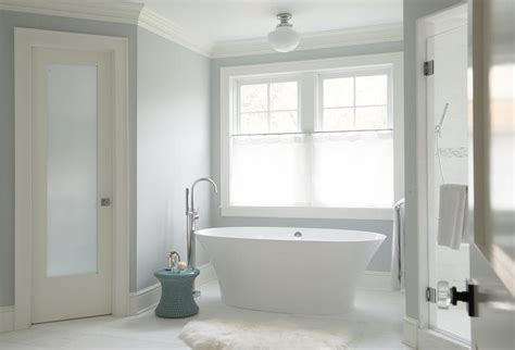 Water Closet Door White And Gray Bathroom With Schoolhouse Flush Mount Oval Tub Transitional Bathroom