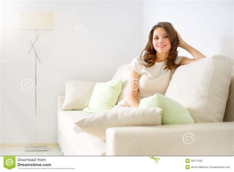 girl sitting on couch smiling girl sitting on sofa stock photography image