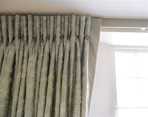 Curtains with goblet pleats on track with covered fascia fine curtains