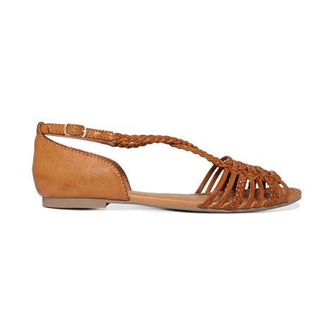 brown s sandals lyst report cristina flat sandals in brown