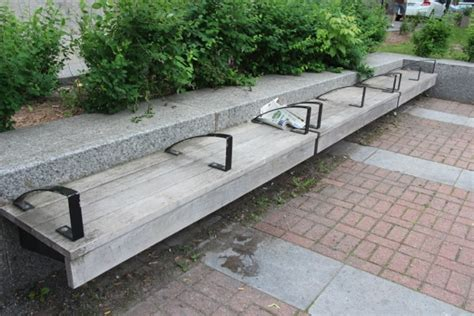 homeless bench some cities have started redesigning their streets and benches to deter the homeless