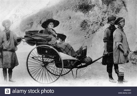 servant to black cock only lady lady in rickshaw in india around 1915 surrounded by
