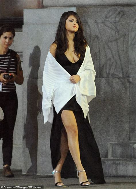 Selena Blouse 2 selena gomez dons plunging black silk blouse at lax daily mail