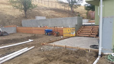 poured in place concrete retaining wall all access constructionall access construction