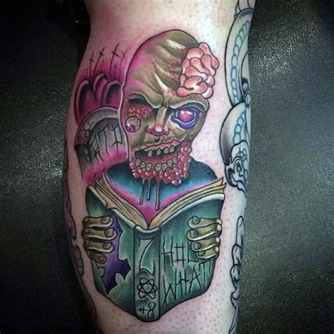 zombie tattoo on leg by graynd tattooimages biz funny looking cartoon style leg tattoo of reading zombie