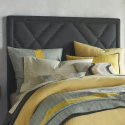 patterned nailhead upholstered grey headboard