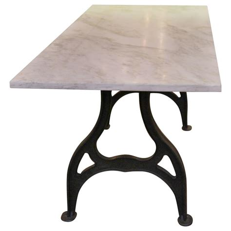 reclaimed marble table with cast iron industrial legs at