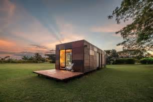 wood bookcase with glass doors tiny modular home in colombia puts the fun in functional