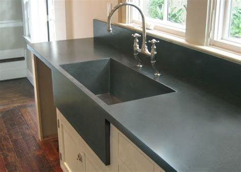 custom kitchen concrete farms sink cast into the