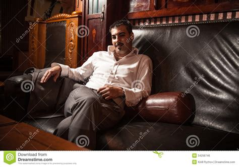 rich couch rich man sitting on vintage leather sofa royalty free