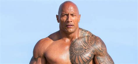 dwayne the rock johnson covers up his brahma bull tattoo