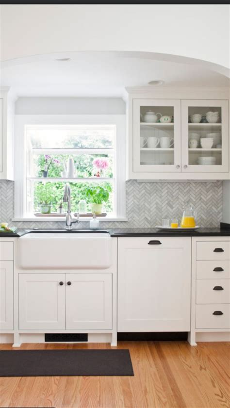 herringbone backsplash herringbone and farmhouse sinks on