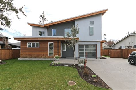 corrugated metal house siding corrugated metal stucco and cedar siding light gray dark gray and cedar color