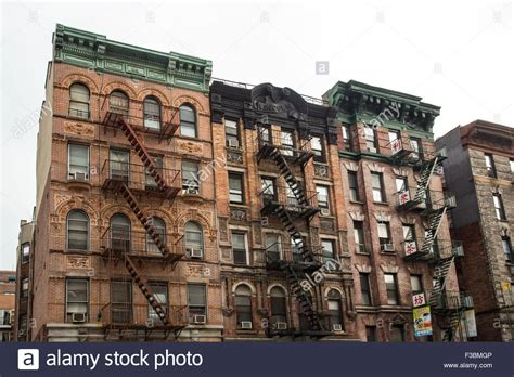 typical new york city apartment building with escapes