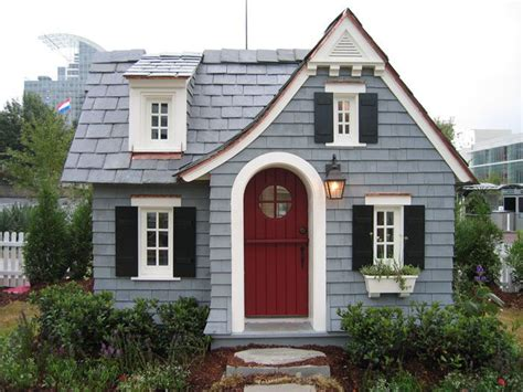 blue house with red door muted icy blue siding deep red door black shutters and