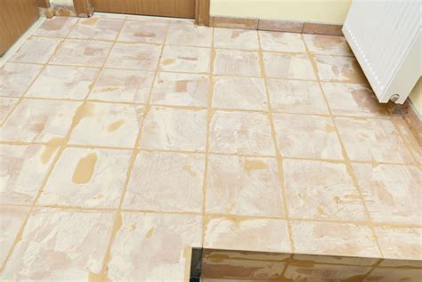 grout tile grouting floor tiles howtospecialist how to build