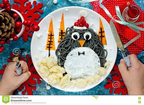 Christmas Fun Food Art Idea For Kids   Penguin Black Spagehetti Royalty Free Stock Image