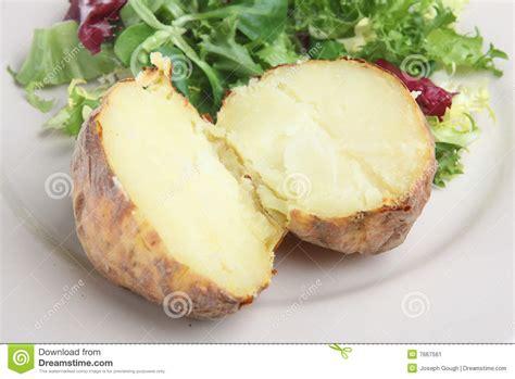 pomme de terre en chambre pomme de terre en robe de chambre simple image stock