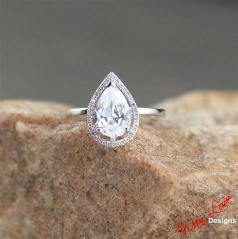 white sapphire pear halo plain band engagement ring