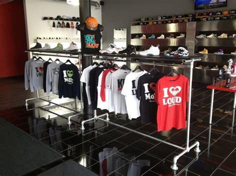 Display Apparel On Showroom Floors - showroom floor retail clothing racks laced up