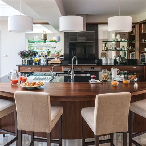 Walnut kitchen with curved breakfast bar   Kitchen