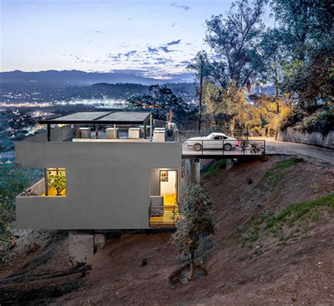 hillside house plan makes contemporary look earthy exquisite house in reverse rooftop driveway leads to hillside home