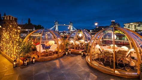 dine in a heated igloo on the banks of london s river dine in an heated igloo overlooking london s tower bridge