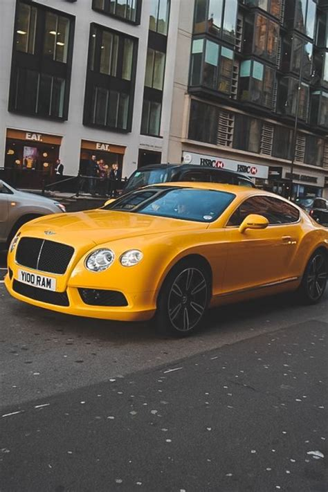 bentley yellow bentley continental looks like one hell of a taxi
