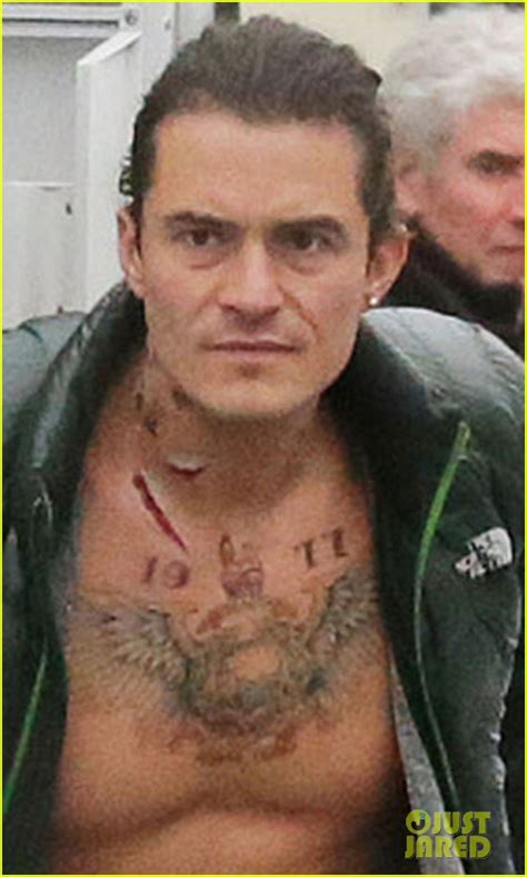orlando bloom tattoo orlando bloom gets shirtless with tattoos for