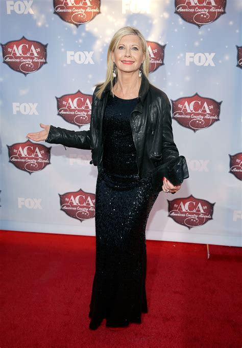 olivia newton john leather pants fugs and fabs of the american country awards ladies in