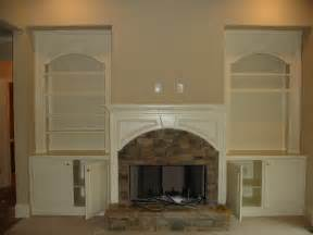 fireplace with built in cabinets shelves around fireplace home ideas