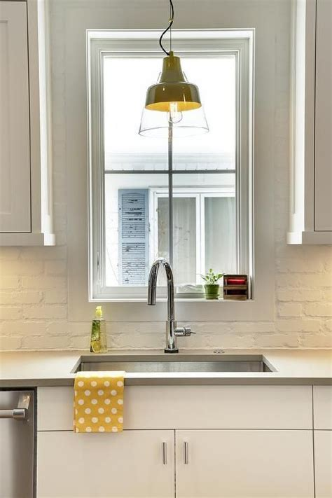 this inviting kitchen features flat front white cabinets best 25 painted brick backsplash ideas on pinterest