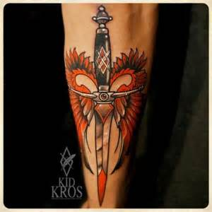 arm dagger wings tattoo by kid kros