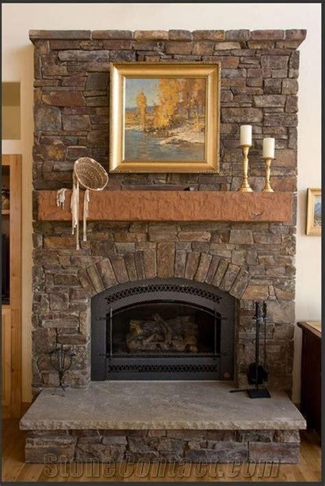 rustic stone fireplace  brown mantel shelf  grey